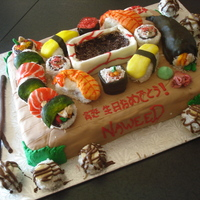 "Sushi Cake Sushi cake! All pieces are mini cupcakes decorated, handroll has cake stuffed in it, dish made out of cake too! Lots of time spent! ""..."