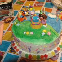 Dora Birthday Cake   Chocolate Cake with butter cream frosting, used spray color to make the grass and sky.