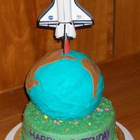 Earthday Birthday Cake. All chocolate with peanut butter buttercream icing. The shuttle is a toy propped up with a sharpened dowel covered in fondant.
