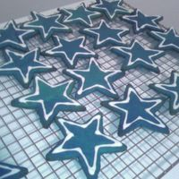 Dallas Cowboys Logo Sugar cookies dyed blue with white RI outline. Dallas Cowboys logo cookies for my boyfriends trip to Dallas this weekend to see his team...