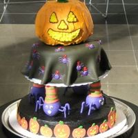 Halloween Cake Pumpkin is chocolate, next is a yellow cake with purple buttercream filling, black buttercream crust coat with fondant blanket cover and...