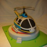 Helicopter   Hard to give the correct shape to cake. Everything is edible apart from the propeler (plastic, taken from a toy)