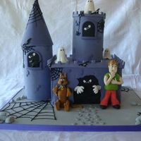 Scooby Doo & Saggy   Both towers has rice crispies inside. Scooby and Saggy are made from modeling paste.