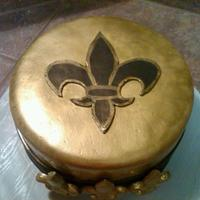 Fleur De Lis Made this cake for a female Saints fan. She loves the Saints, but wanted a more feminine cake.