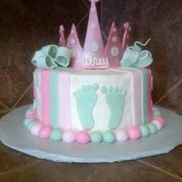 Baby Feet Made this for a Baby Shower. Crown is gumpaste, cake is iced in buttercream, accent are fondant. Thanks for looking!
