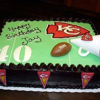 Chiefs Cake KC Chiefs cake. Ganache with green fondant. Jay turned 40. Chocolate Chiefs logo, pennants, and numbers. fondant football, Pastillage...