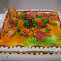 Fall Tiedye This is a buttercream TieDye frosted with GumPaste and fondant Leaves and AppleThe Flowers are Buttercream Carnations and Roses