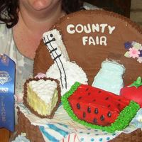 County Fair 2006 I did this cake for the 2006 Hamilton County Fair. It was a Blue Ribbon Winner. I made the cake to look like the County Fair logo. It is...