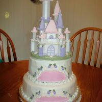Castle Cake This cake was for twin girls 1st Birthday. I bought a cake topper of the castle in styrofoam and then embellished it.