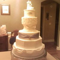 Wedding Dress Cake This cake was made to mimic some of the details of the wedding dress. It is covered in fondant with cornelli lace, antique lace, pearl,...