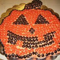"Jack O Lantern Cupcake Cake I made this for Halloween of 2006. I used M&Ms -- bought a ""Halloween"" themed bag, only used the brown (or black, can't..."