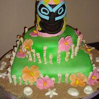 Hawaiian Cake tiki is rkt, top tier chocolate cake bottom tier orange rum cake and chocolate shells