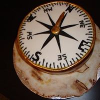 Compass i did this for a history teacher for her bday he bf asked me to... underneath is a antique map of puerto rico that i did in fondant ...she...