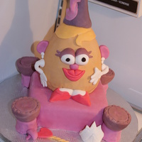 Princess Potato Head   Wanted to put more details on the castle but was outta time... Shoes and mouth look funny but hey, its a funny cake ;)
