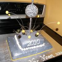 New Years 2010  This was for the family so I made this cake to practice a few things I always wanted to try (like using silver dust, wires... ) It turned...