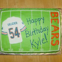 Urlacher Birthday Cake This is a cinnamon swirl cake with buttercream frosting. The Urlacher jersey is a frozen buttercream transfer. The rest of it is freehand....