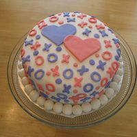 Hugs & Kisses Snickerdoodle cake with BC, Covered in MMF with MMF Accents