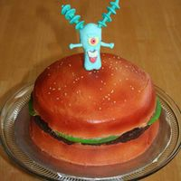 Plankton's Revenge   My son's birthday cake modeled after an aquarium ornament. Plankton and lettuce are MMF the rest is buttercream.
