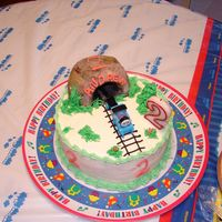 Small Train Cake For Family Party Same thing as my big Thomas cake, but a smaller scale for a separate, smaller family birthday party. I used the same tunnel from the bigger...