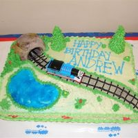 Thomas Train Cake Andrew's 3rd Train BirthdayButtercream Cake, buttercream details. Tunnel made out of a muffin coated with buttercream, trees an ice...