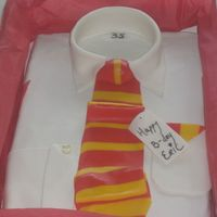 Shirt Cake Chocolate Cake, with Kahlua frosting, with Satin Ice fondant on the top. I put it in a real shirt box with real tissue paper and put the...
