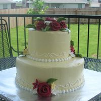 Sweet Sixteen In Yellow And Red   White cake with buttercreamicing. Fondant flowers. The party colors were yellow and red.