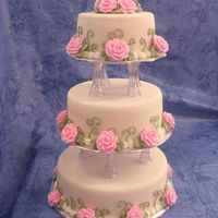 Romantic Wedding Cake This cake was made for a display, so it is styroform covered with fondant and royal icing border, leafs and roses. It was lot easier to...