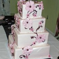 Ivory, Pink And Brown Buttercream icing and fondant / gumpaste flowers. TFL :)