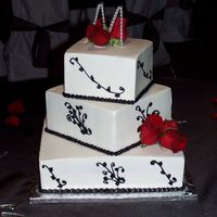 Black And White Wedding  Cakes were yellow marble and french vanilla with raspberry and chocolate mousse fillings and BC frosting. Patterned from a picture the...