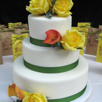 Garden Wedding   Bride wanted a really simple cake with fondant, fabric ribbon and fresh flowers. Cake flavors are chocolate and lemon.