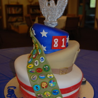 Topsy Turvy Eagle Scout Cake 3-tier Topsy Turvy cake Eagle Scout Cake. The topper is gumpaste and modeling chocolate, the sash is modeling chocolate and all the badges...