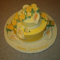 Anniversary Cake gold, buttercrean roses and fondant callas
