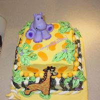 Jungle Baby Shower layered choc. and white cake, buttercream icing with mmf decorations, some chocolate animals as well.