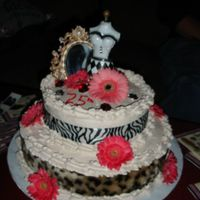 Leopard 25th brithday cake. Chocolate with fresh strawberries. Leopard and zebra print ribbon with fresh daisies.