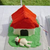 Snoopy Cake Snoopy is on the bottom because he kept falling off the roof of the house. Buttercream icing and snoopy out of fondant.