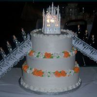 Quinceanera a quinceanera cake i did the colors were silver and orange, the castle ontop is the wilton castle it is really pretty when its all lighted...