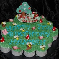 Backyard Fun - Hannah's 7Th Birthday Cupcake cake for a little girl who was having a backyard party. The invited guests were told to wear their gumboots and old clothes as the...