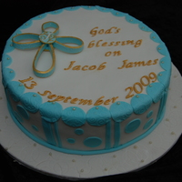 Jacob's Baptism Choc cake with dark choc ganache and covered with fondant. The cross is made from modelling paste so that it can be kept as a keepsake. The...