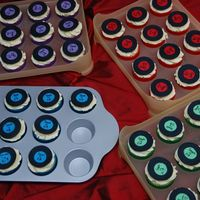 Matching Cupcakes Cupcakes with mini records to go with the Record Player cake for my niece Sarah's 21st birthday. 2 blue ones fell and had to be eaten...