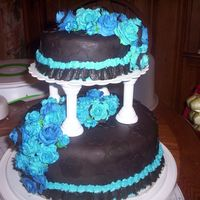 Wanted Something Diff.   black fondant with blue fondant roses