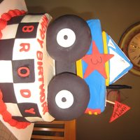 Monster Truck Buttercream with fondant. Everything is edible except the truck support and the roll bar