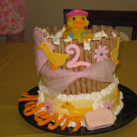 Rubber Ducky French vanilla cake covered in BC with fondant accents. Pirouettes were used around the top layer