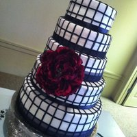 Blackandwhite Black and white cake in buttervream with fondant accents. Cake was red velvet