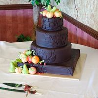 Michelle And Jon This was a 4 tiered cake, chocolate, banana, cherry chocolate chip, and marble cake covered in dark chocolate satin ice. All of the fruit...