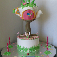Tinkerbell Cake 2 Tier cake, garden theme on base tier Tinkerbell's tea pot house on top tier-all cake except for tree which was PVC tube covered in...