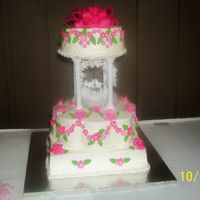 "Edmonds Wedding  12 ' petal stacked on 12"" square tiered with 8"" round. gumpast flowers and leaves with fondant bow. made my Granny Debbieand..."