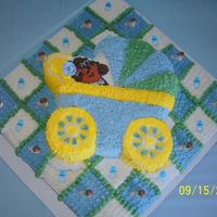 Taz Buggy On Quilt   Taz baby buggy on square quilt