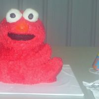 Elmo For Bradley's 1St Birthday  My first attempt at a 3D Elmo for my grandson's 1st birthday. I used the stand up bear pan. The cake is chocolate of course! The eyes...
