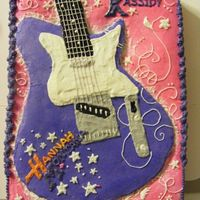 Hannah Montana This is Hannah Montana's electric guitar from the show (apparantly). My 2nd commisioned cake :) The guitar is slightly carved into the...