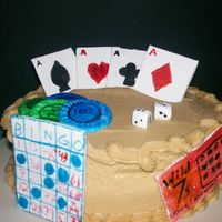 Gambling Cake!! I did this cake for my portfolio. It is Chocolate with raspberry filling and peanut butter icing. The decorations are fondant. It was my...